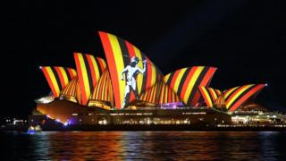 The colours of the Aboriginal flag are projected on to the Sydney Opera House in 2016