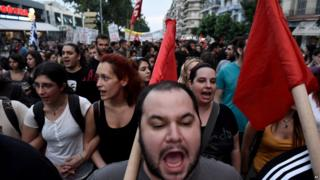 "Demonstrators shout slogans during a rally by supporters of the ""No"" vote to the upcoming referendum in the northern Greek port city of Thessaloniki,"
