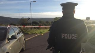 Police at the scene of a paramilitary-style shooting in Dungiven