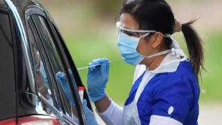 Medical staff are seen testing people at a coronavirus test centre in the car park of Chessington World of Adventures as the spread of the coronavirus disease (COVID-19) continues, Chessington, Britain,