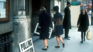 Women at a polling station in the 1970s