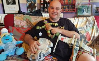 JJ Lucia-Wright with some of the donated toys