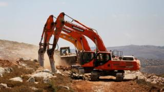 Diggers break ground for the new Jewish settlement of Amichai in the occupied West Bank (20 June 2017)