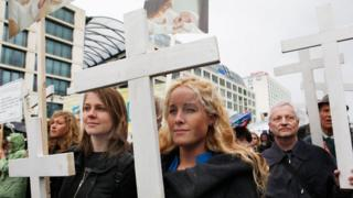 Anti-abortion activists carry crucifixes during a march in September 2010 in Berlin.