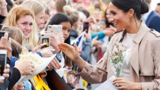 The Duchess of Sussex meets crowds during a walkabout in Auckland, New Zealand