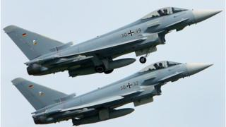 File pic of two Eurofighter jets of the German Air Force taking off from the air base in Rostock-Laage, northeastern Germany