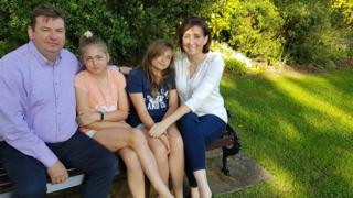 Claire McQuillan, with husband Martin and twin girls Sophie and Elizabeth, 11