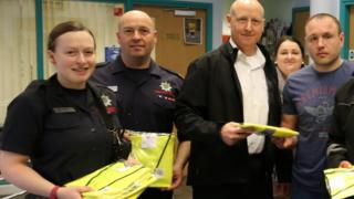 Wisbech firefighters giving out jackets