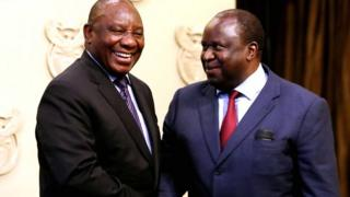 President Cyril Ramaphosa (L) with minister Tito Mboweni