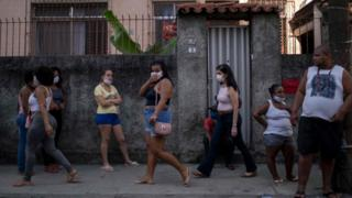 People wearing masks in the street in Sao Paulo, Brazil.