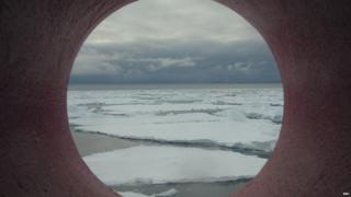 Pack ice view through the circular window of the ship.