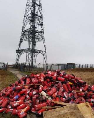 The dumped fire extinguishers