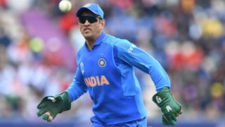 India's Mahendra Singh Dhoni fields during the 2019 Cricket World Cup group stage match between South Africa and India at the Rose Bowl in Southampton, southern England, on June 5, 2019