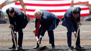 "U.S. President Donald Trump (C) takes part in a groundbreaking with Wisconsin Governor Scott Walker (L) and Foxconn Chairman Terry Gou during a visit to Foxconn""s new site in Mount Pleasant, Wisconsin, U.S., June 28, 2018"