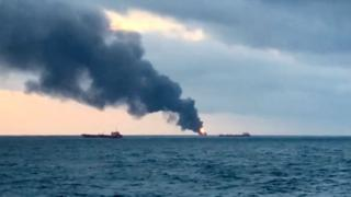 Smoke rising from a fire on a ship in the Strait of Kerch near the Crimea, January 21, 2019