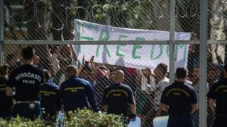 "Migrants chant the slogan ""Freedom"" as they protest demanding better conditions and faster administrative process deciding about their asylum claim"