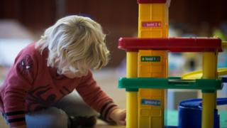 Child playing with a toy set at a nursery