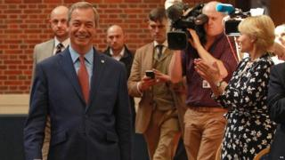 Nigel Farage arrives to announce his resignation as UKIP leader