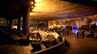 Migrants tents are surrounded by the police forces in Paris on 7 November 2019