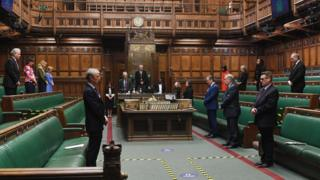 MPs in the Commons stand in silence