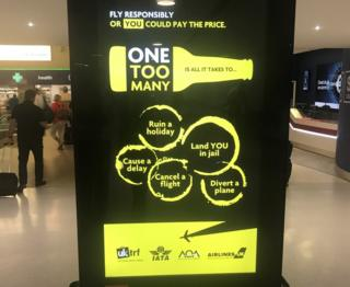 One Too Many campaign on screen at Manchester airport