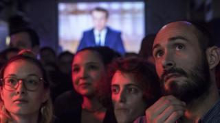 "Supporters of French presidential election candidate Emmanuel Macron for the ""En Marche!"" movement (Onwards!) watch a live brodcast of the face-to-face televised debate between Emmanuel Macron and far-right Front National (FN) party candidate, Marine Le Pen in a bar in Paris, France, 03 May 2017."