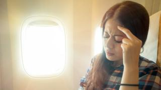 Worried woman on plane