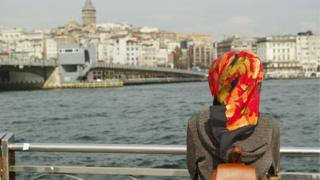 A Muslim woman looking admiring a view