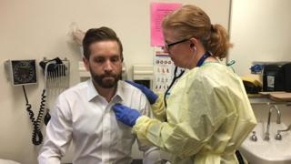 Dr Anne Stephenson listens to patient Erick Bauer's heart beat