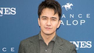 Actor Zhai Tianlin attends the Prix de Diane Longines 2018 at Hippodrome de Chantilly on June 17, 2018 in Chantilly, France