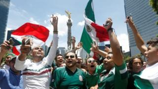 Soccer Football - FIFA World Cup - Group F - Germany v Mexico - Mexico City, Mexico - June 17, 2018 - Mexican fans celebrate at the Angel of Independence monument.