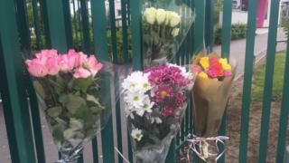 Flowers at the school gate for Megan