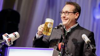 Heinz-Christian Strache, Austrian Vice-Chancellor and leader of the Austrian Freedom Party FPOe, holds a beer mug as he delivers a speech in Ried, Austria on 14 February 2018.