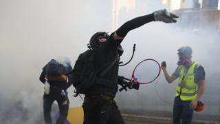 Protester throws back tear gas canister - 1 October