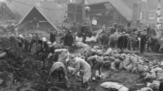 Rescue workers at the scene of the Aberfan disaster the following day