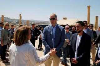 Prince William stands with Crown Prince Hussein during his visit to the ancient city of Jerash