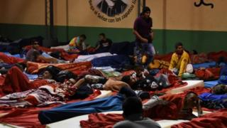 Migrants bed down for the night at a shelter in Guatemala City