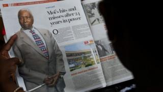 A person reads a newspaper article the death of former Kenya's President Daniel arap Moi, in Nairobi on 4 February 2020