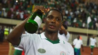 Odion Ighalo drinks Champagne to celebrate World Cup match