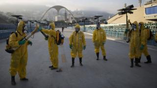 Health workers in Brazil fumigate a stadium in Rio