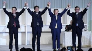 Yoshihide Suga (third from left) celebrates after winning the party leadership