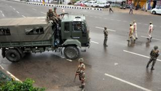 Army personnel stand guard during restrictions on August 5, 2019 in Jammu, India.