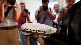 The bag used to collect samples of the Moon is displayed at Sotheby's