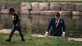 Groom Clayton Cook saved a boy from drowning