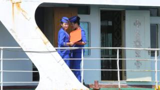 Two women aboard a ship