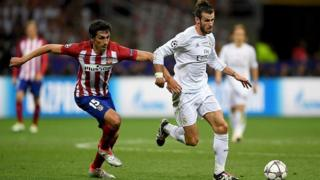 Gareth Bale of Real Madrid battles for the ball with Stefan Savic of Atletico Madrid during the 2016 UEFA Champions League Final