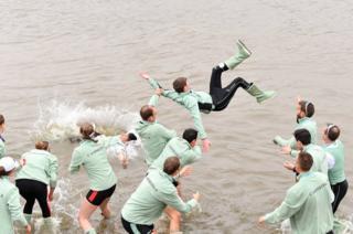 The crews of Cambridge University celebrate
