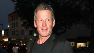 Lance Armstrong looks on while attending an event in Los Angeles in 2018