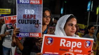 Demonstrators in India hold placards to protest against sexual assaults on women. File photo