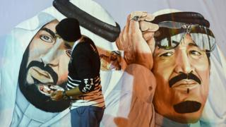 Saudi artists paint a mural portrait of King Salman bin Abdulaziz (R), and his son Crown Prince Mohammed bin Salman, during the 32nd Janadriyah Culture and Heritage Festival, held on the outskirts of the capital Riyadh on 17 February 2018.